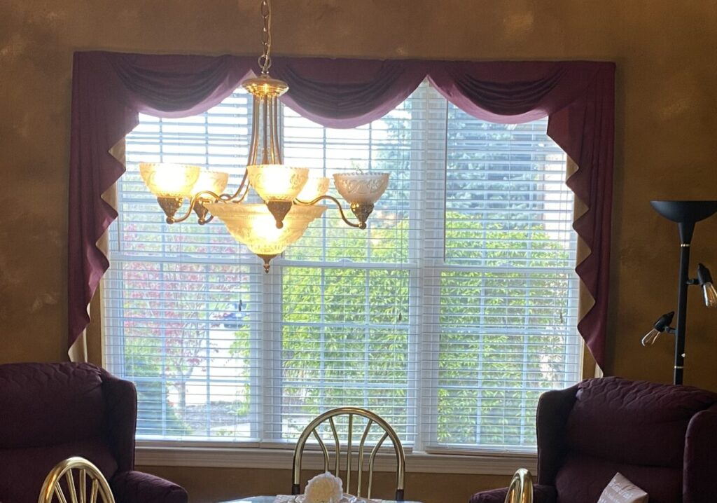 We will add light airy window treatments for this farmhouse dining room.
