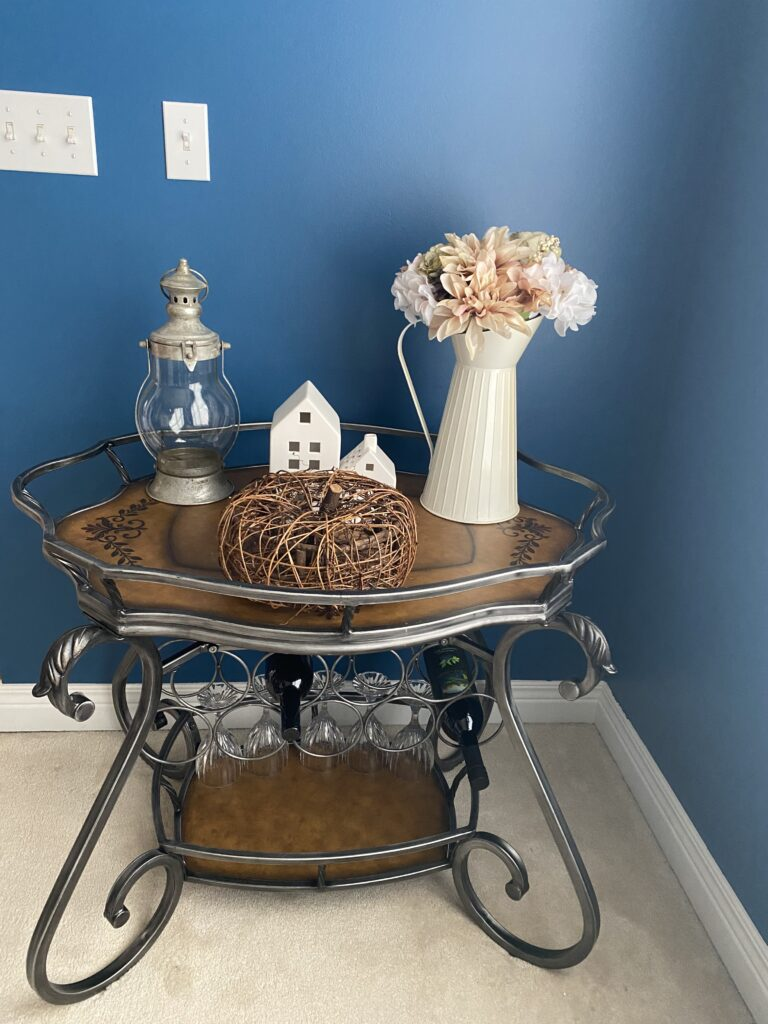 Wine rack, bar cart, dining room furniture.